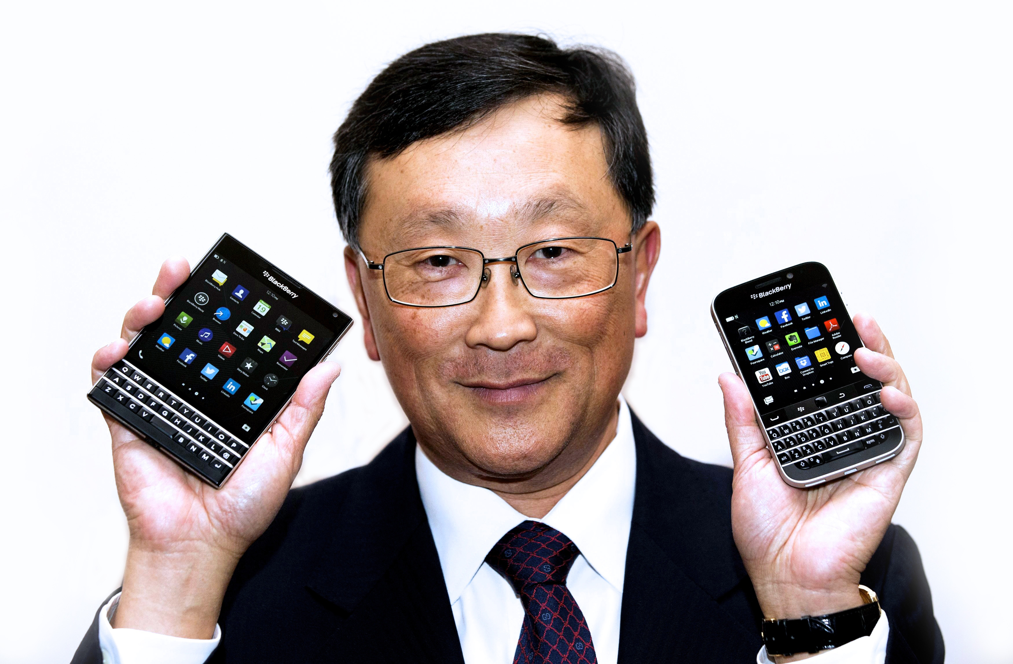 BlackBerry CEO Chen holds up the unreleased Blackberry Passport and Blackberry Classic devices during the company's annual general meeting for shareholders in Toronto