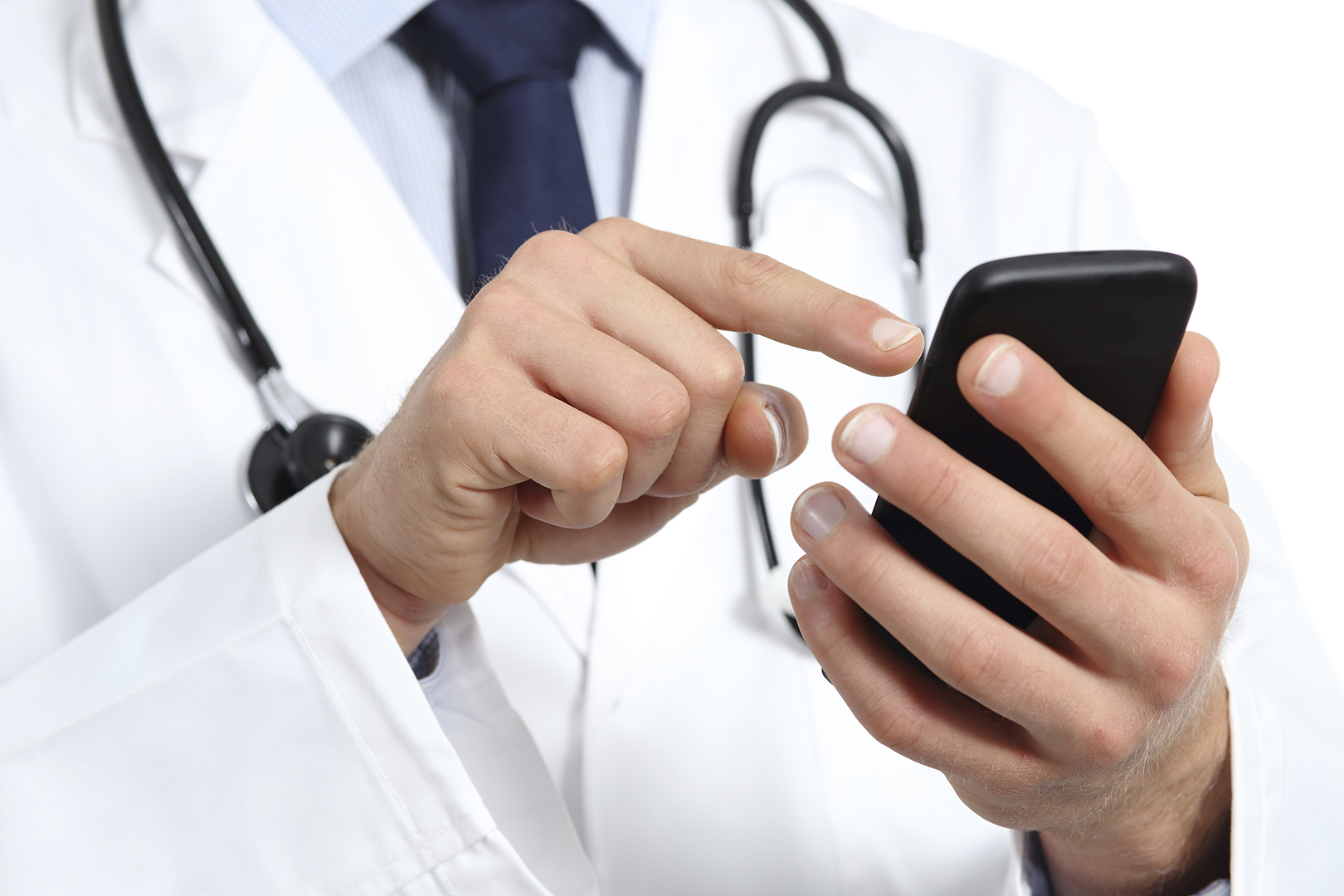 Doctor hands texting on a smart phone isolated on a white background